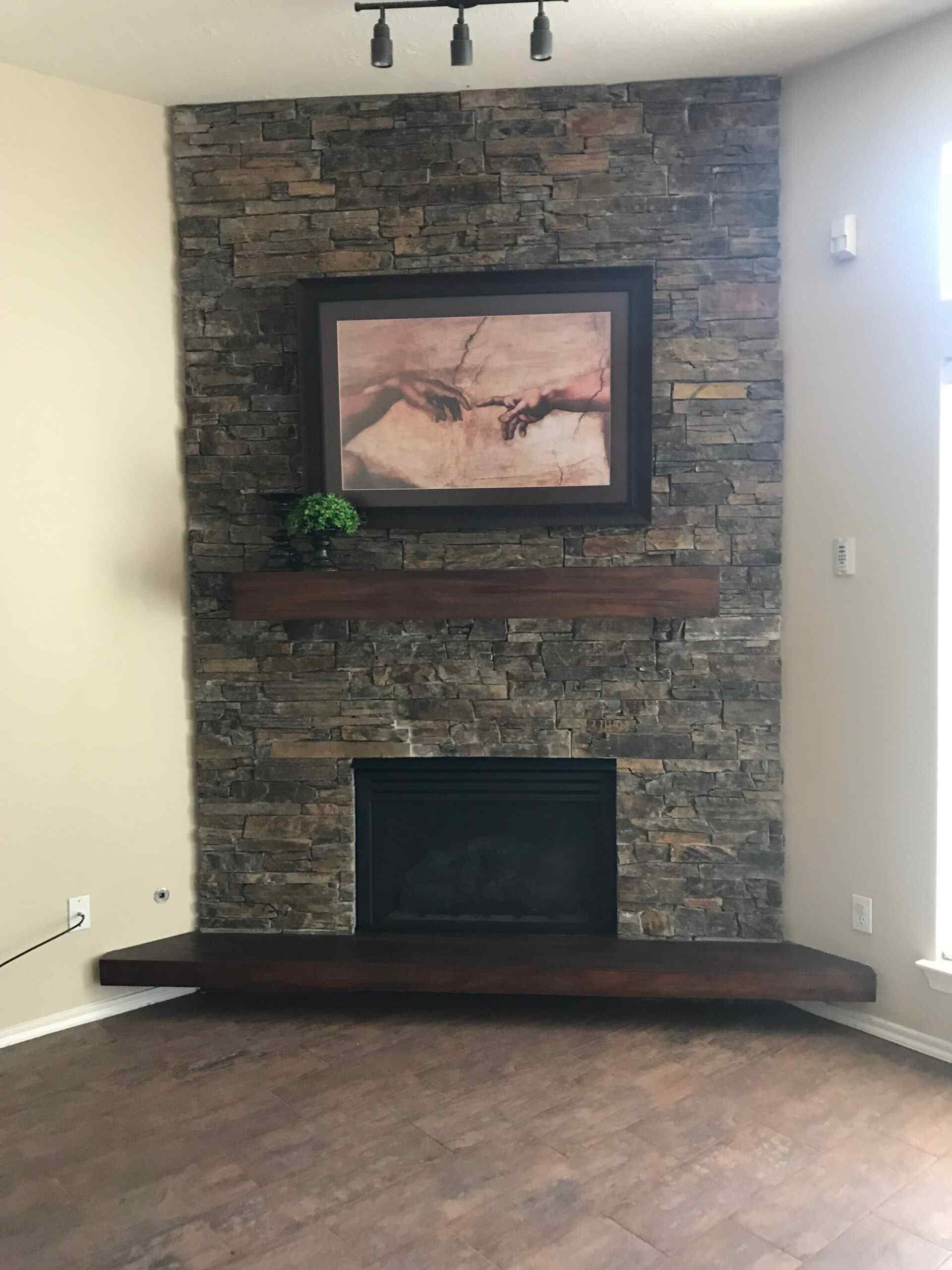 Flooring Land – Stone Fireplace